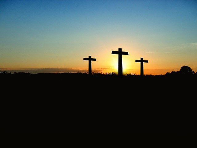 Three crosses in front of the sunrise